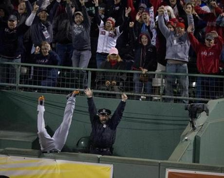 Boston, Ma-October 13, 2013 Globe Staff photo by Stan Grossfeld==Sox vs. Detroit-Game 2 ALCS---Torii Hunter falls into bullpen trying to catch David Ortiz HR in 8th.